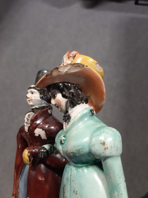 Lot 15 - A Staffordshire pearlware group of Dandies, early 19th century.