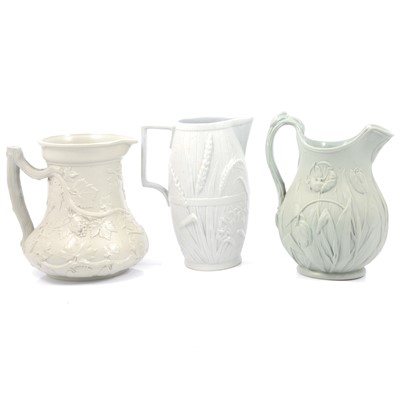 Lot 49 - Stoneware Society of Arts jug, Harvest Barrel jug and a Tulip jug