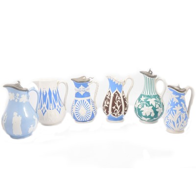 Lot 65 - Stoneware Arches & Scrolls jug and five other jugs