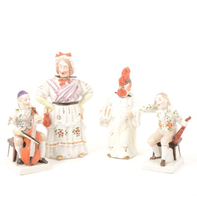 Lot 33 - Pair of German porcelain musicians, and two nodding head figures.