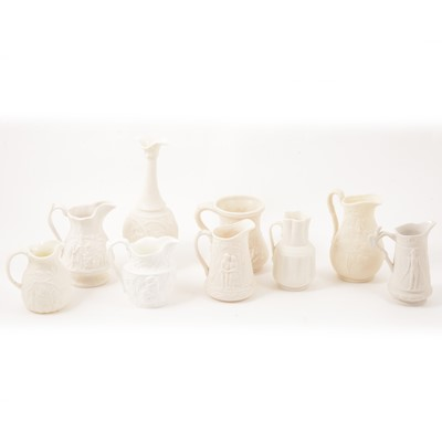 Lot 35 - White pottery jugs and Parian type wares.