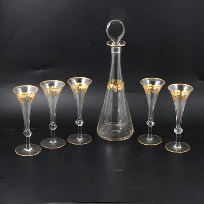Lot 30 - Continental glass decanter and five flutes.