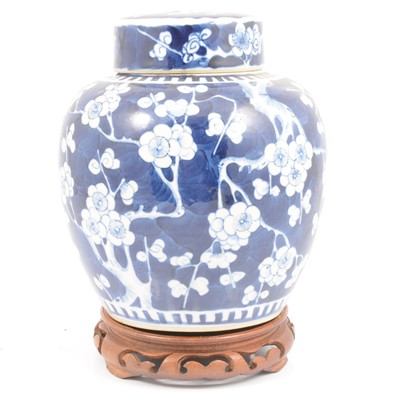 Lot 34 - Chinese porcelain blue and white ginger jar and cover, on a hardwood stand.