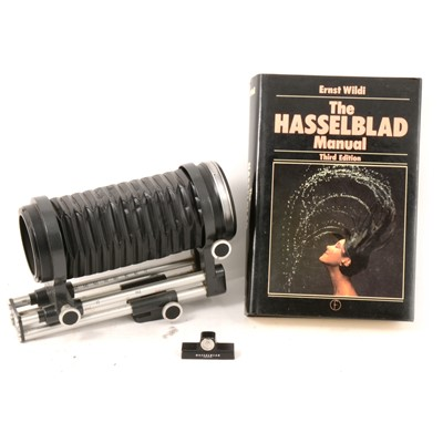 Lot 33 - Pair of Hasselblad medium bellows, level and book.