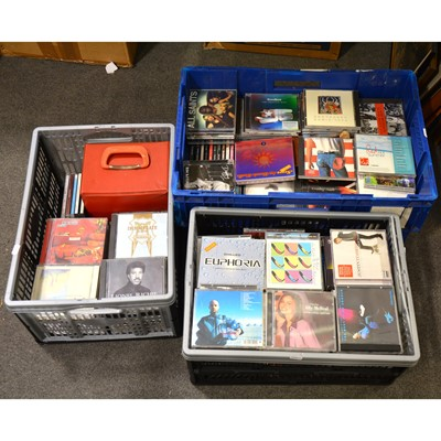 """Lot 16 - Three boxes of music CDs, mostly pop, and a small case of 7"""" vinyl records"""