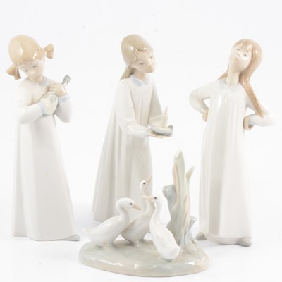 Lot 28 - Three Lladro figures and a Nao group of geese.