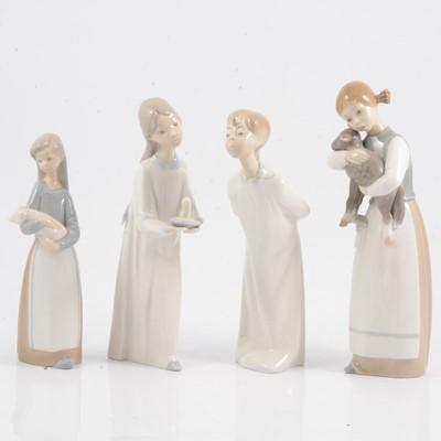 Lot 36 - Four Lladro figures.