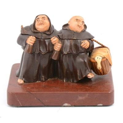 Lot 95 - Cast and cold-painted metal novelty inkwell, formed as two merry monks.