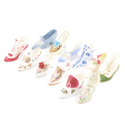 Lot 49 - Collection of twenty-three decorative porcelain shoes and fourteen jugs.