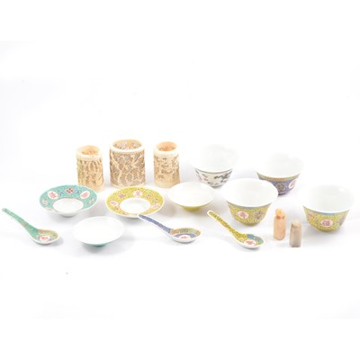 Lot 24 - Chinese carved and pierced ivory vases, hard-stone seals and modern rice bowls and spoons.