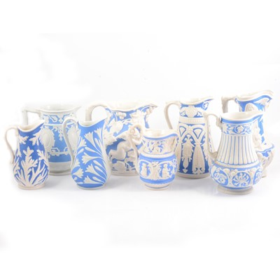 Lot 39 - Eight Victorian relief-moulded jugs, various makers.