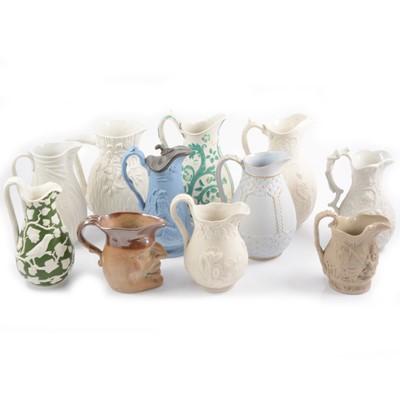 Lot 47 - Eleven assorted Victorian decorative jugs