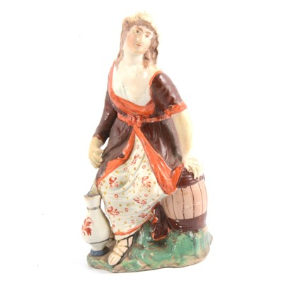 Lot 52 - Early Staffordshire pearlware figure, Washer Woman