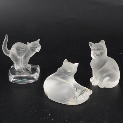 Lot 1023 - Lalique Crystal, Happy Cat, a frosted glass figure, and two other cat figures