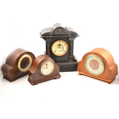 Lot 104 - A black slate mantel clock and three other wooden cased mantel clocks.