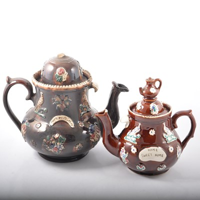 Lot 10 - Five Measham Bargeware teapots and a milk jug.