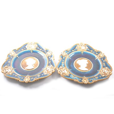 Lot 19 - Pair of Geman wall plates, cameo centre surrounded by vignettes.