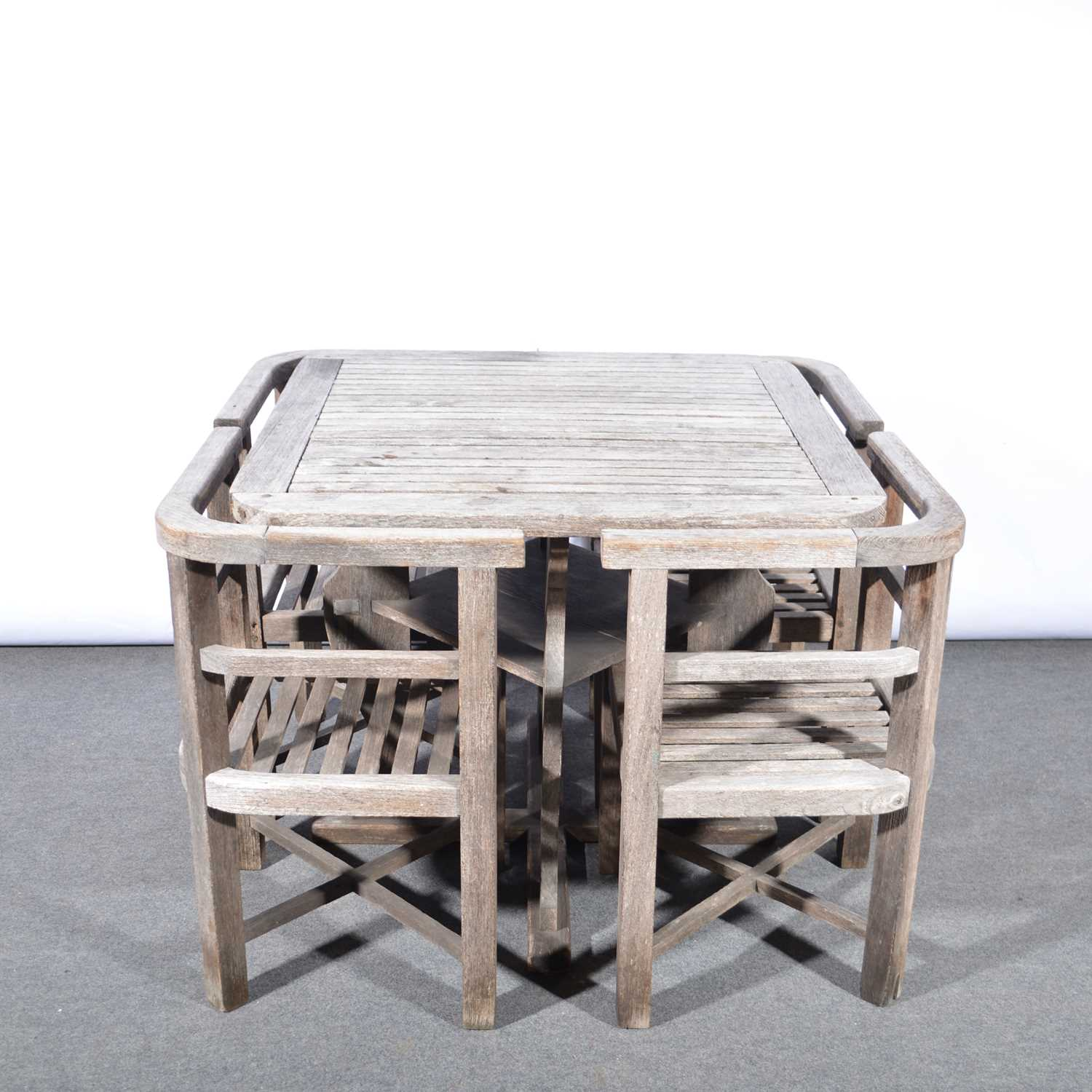 Lot 1029 - 'Collingwood' teak garden table and four chairs, retailed by Heals