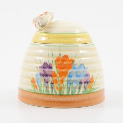 Lot 1018 - Clarice Cliff, a Crocus beehive preserve pot and cover, and an Aurea plate.