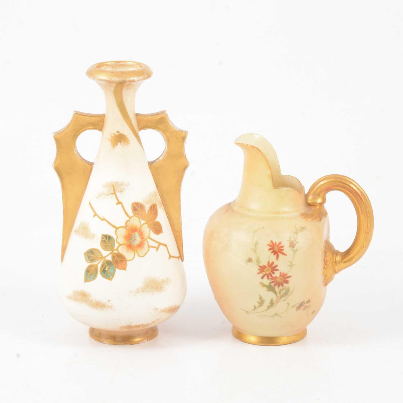 Lot 33 - A Royal Worcester blush ivory jug, Royal Bonn twin handled vase.