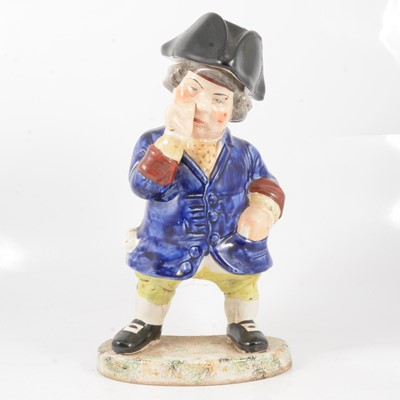 Lot 29 - A 19th century snuff taking standing man toby jug with hat.