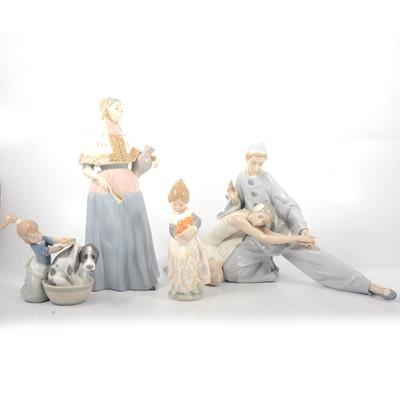 Lot 38 - Four Lladro figurines.