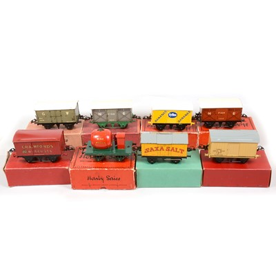 Lot 41 - Eight early Hornby O gauge model railway vans and rolling stock.
