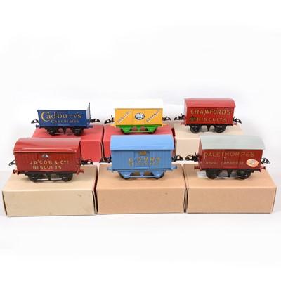 Lot 48 - Six Hornby O gauge model railway vans with advertising