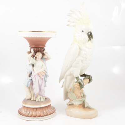 Lot 11 - A Royal Dux cockatoo with yellow plumage and a continental coloured bisque figure group.