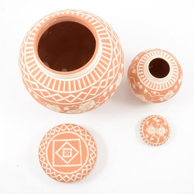 Lot 1031 - Two terracotta and sgraffito ginger jar and covers by Peter and Gaye Fishley Holland