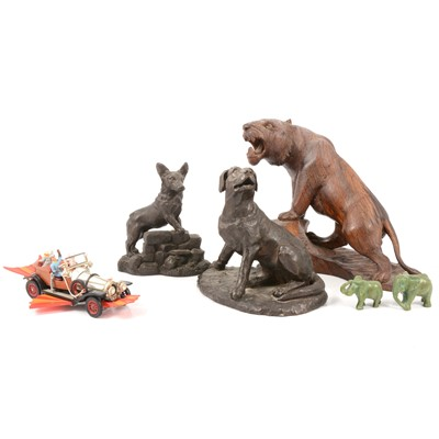 Lot 83 - Two bronzed resin figures of dogs, a carved tiger, etc