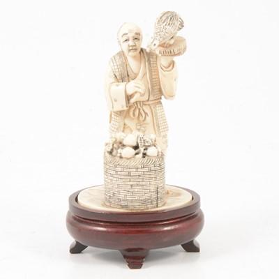 Lot 85 - Japanese carved ivory okimono of a street vendor