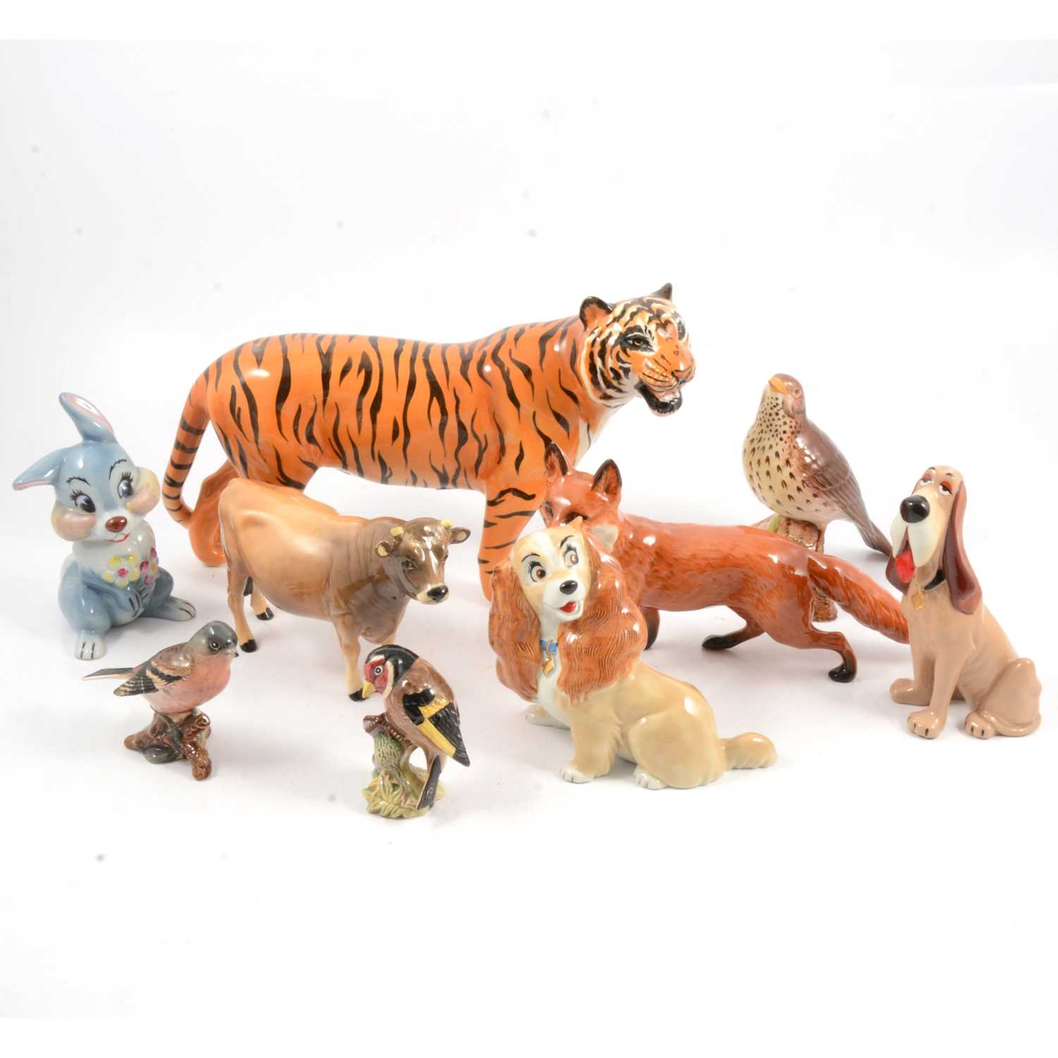Lot 23 - Beswick tiger and other animals and birds, and Wade Disney blow-ups.