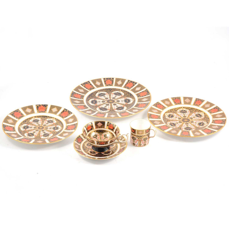 Lot 14 - Royal Crown Derby 'Imari' pattern plates, trio, hexagonal vase and lid.