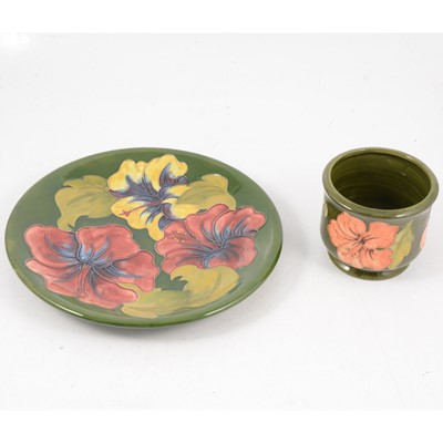 """Lot 47 - Moorcroft Pottery, Hibiscus pattern jardiniere and a 10"""" plate"""