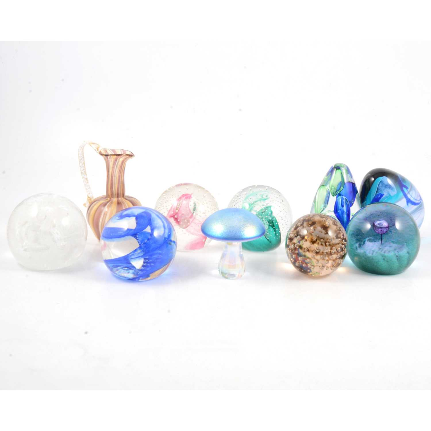 Lot 17 - Nine Caithness and other glass paperweights, and a Murano glass vase.