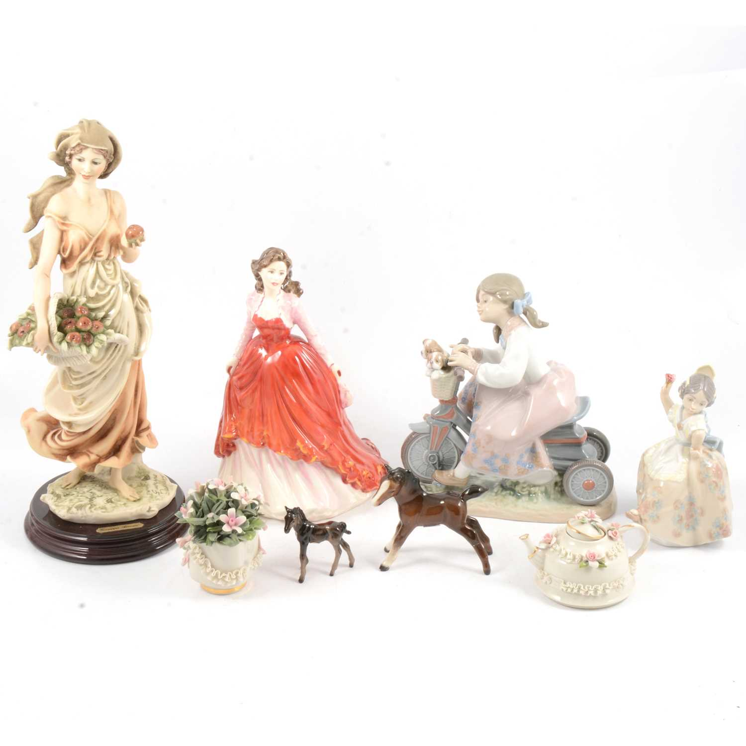 Lot 29 - Guiseppe Armani Florence 'Fresh Fruit', Royal Doulton and LLadro figures and other decorative ceramics.