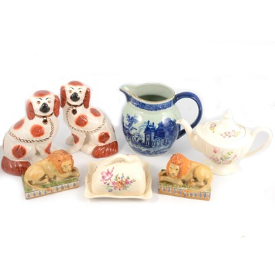 Lot 86 - Pair of flat back dogs, pair of lions, Wedgwood clock and other decorative ceramics.