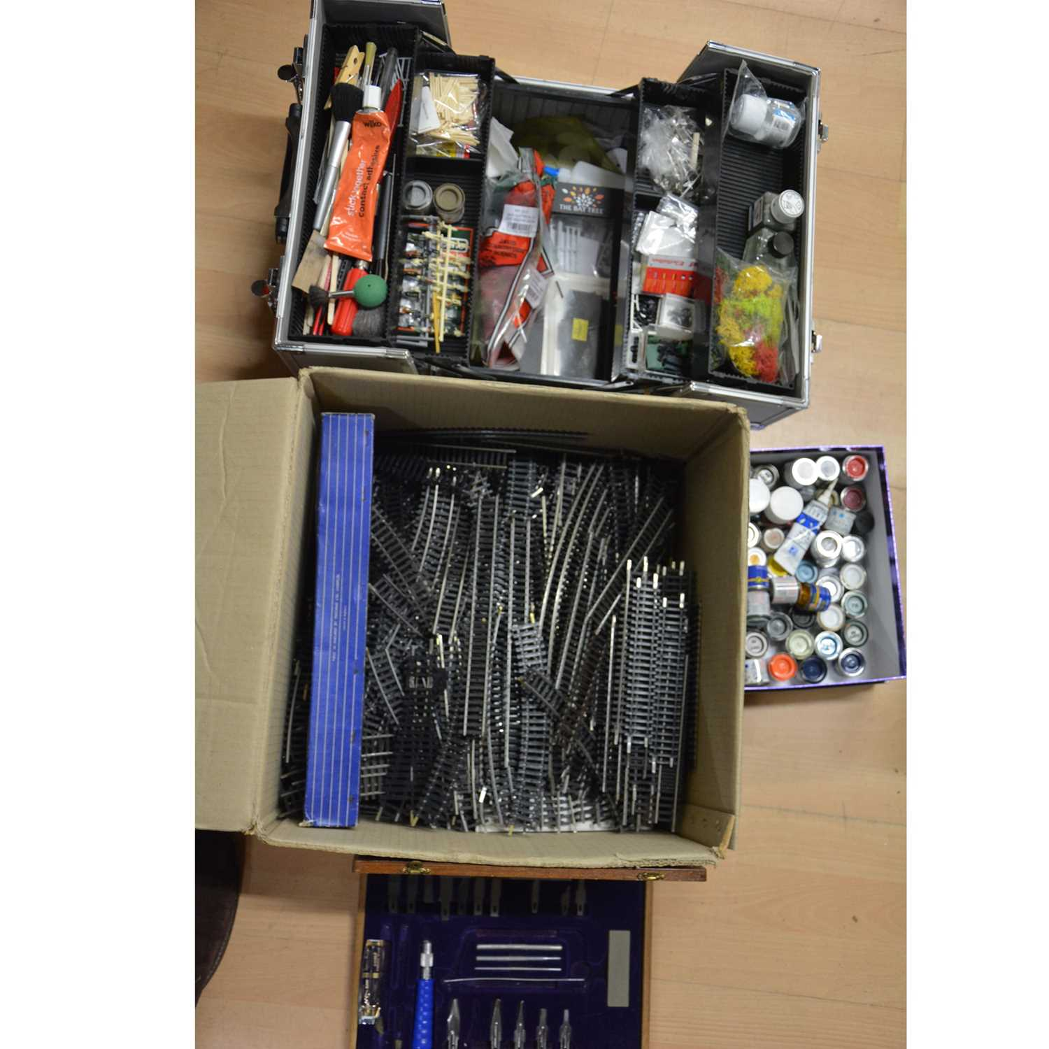 Lot 29 - A case of model railway accessories, parts, paints and spares