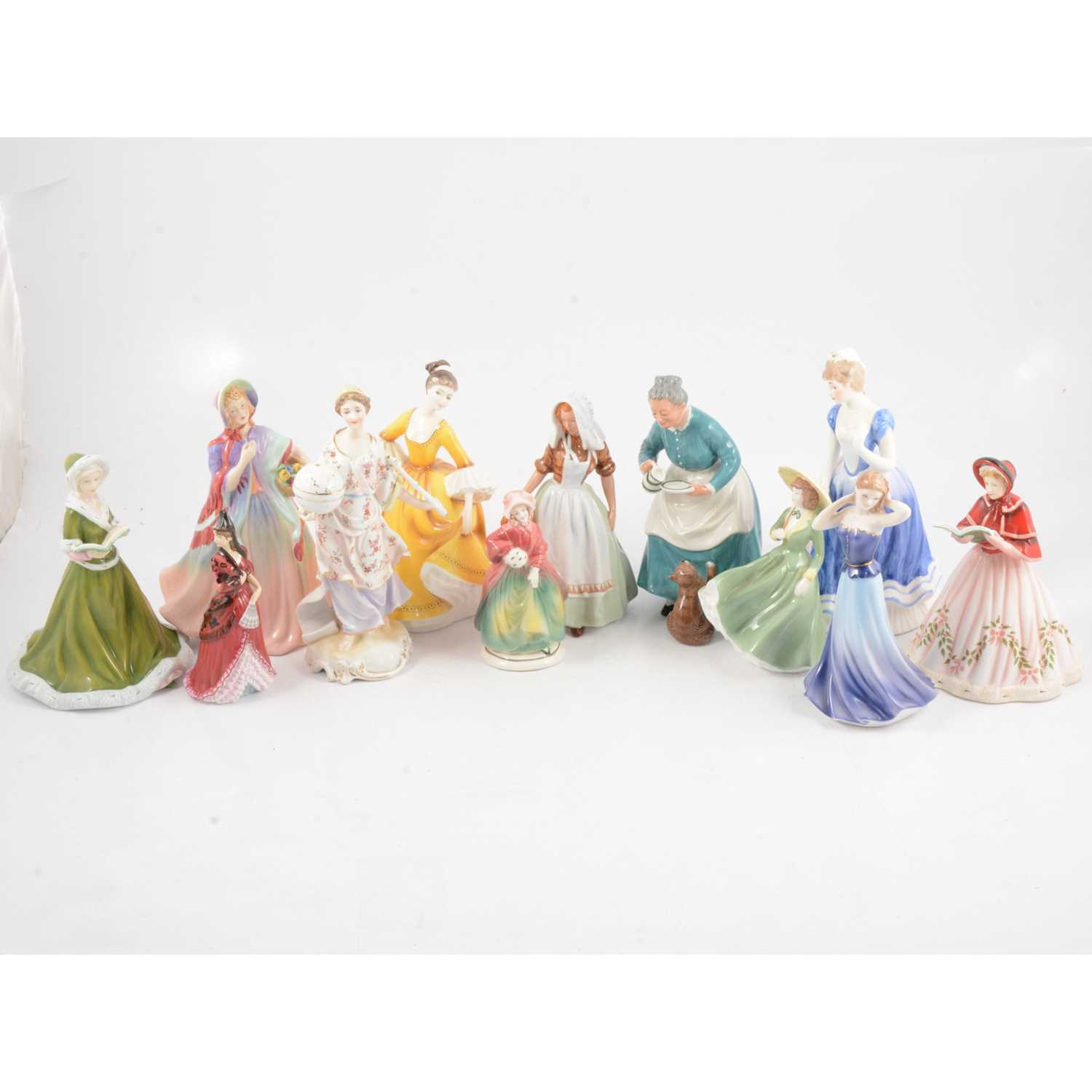 Lot 45 - A collection of twelve bone china figurines