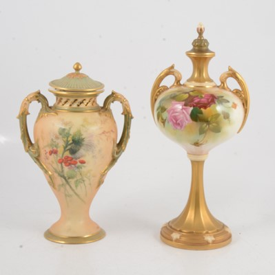Lot 73 - Two Royal Worcester blush ivory vases and covers
